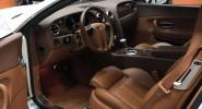 Bentley Continental - фото сбоку